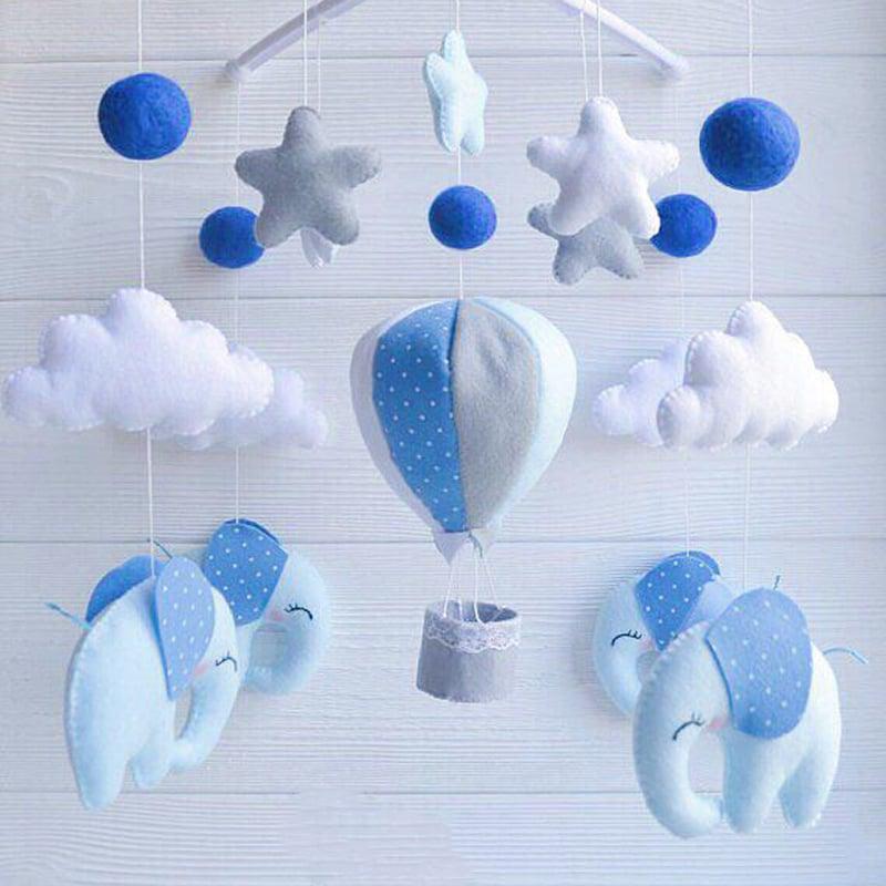 Мобіль на ліжечко новонародженому хлопчикові Блакитні Слоники
